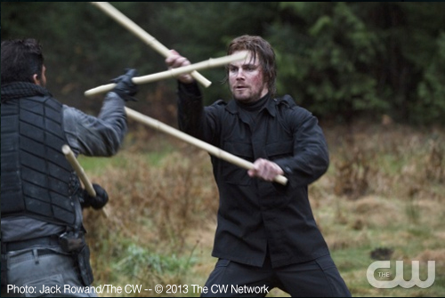 Slade teaches Oliver to fight