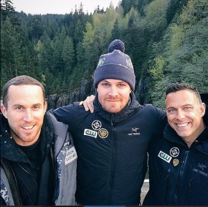 James with Stephen Amell and Simon Burnett